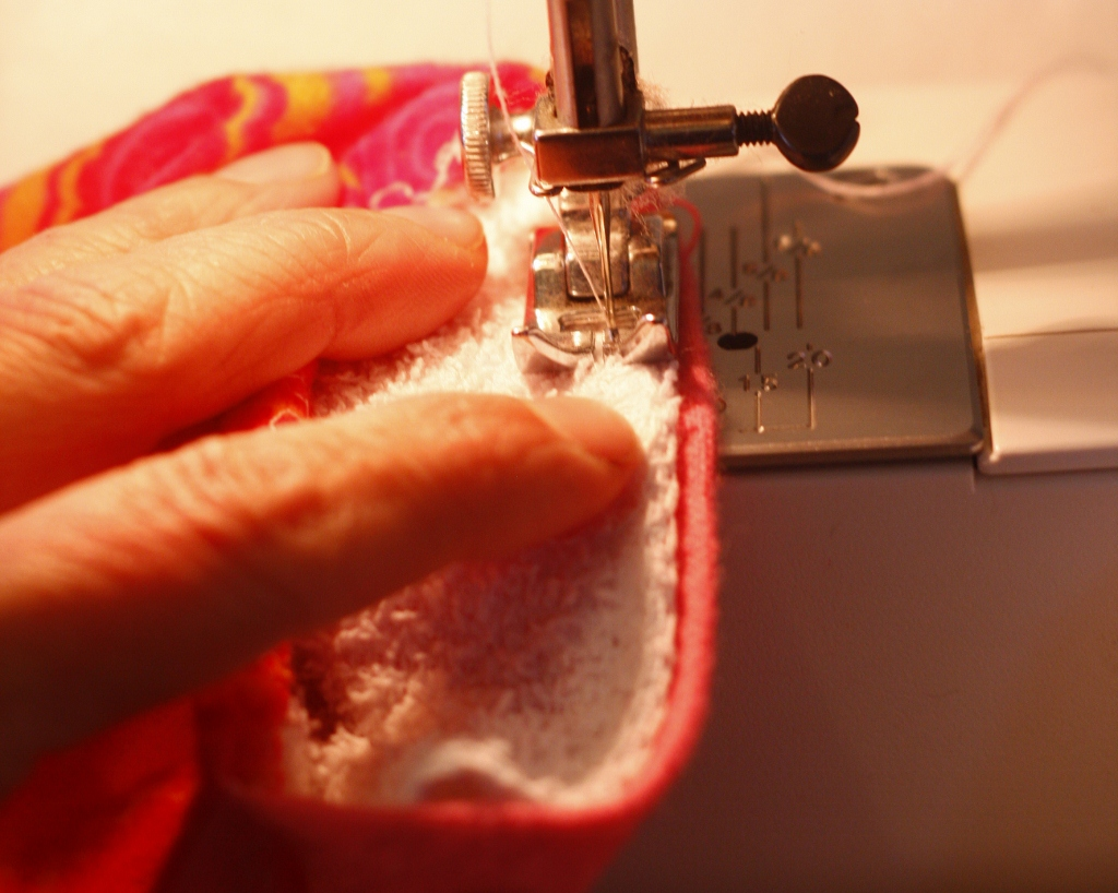 Sewing the soaker layer to the back edge of the diaper
