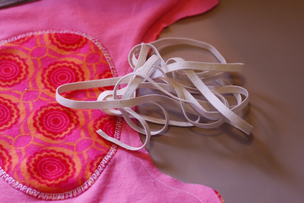 1/4 inch elastic for leg holes and front and back of diaper if desired