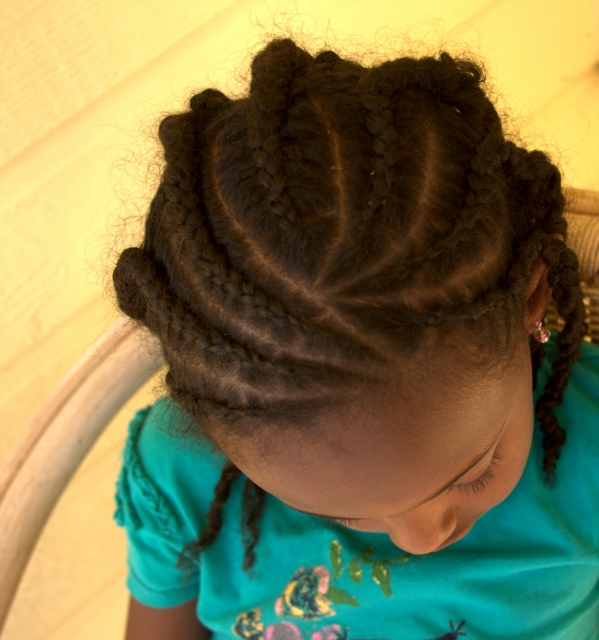 Cornrows with an angled part