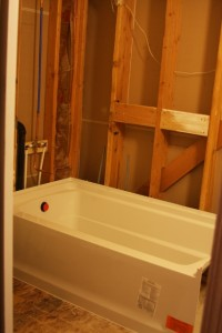 New tub in a nearly gutted bathroom